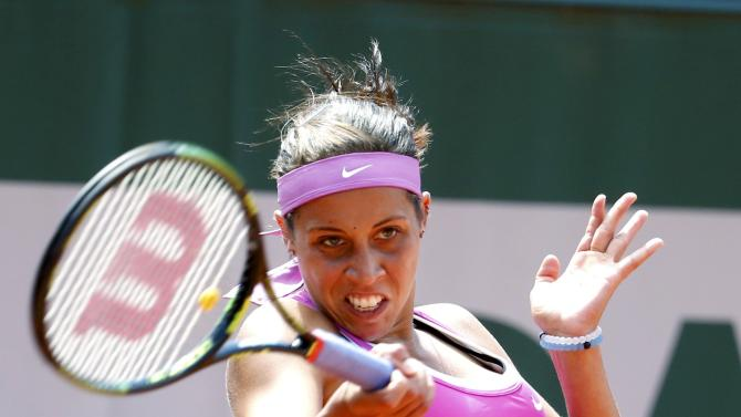 Madison Keys of the U.S. plays a shot to Timea Bacsinszky of Switzerland during their women's singles match at the French Open tennis tournament at the Roland Garros stadium in Paris