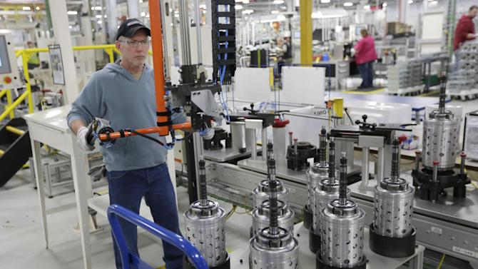 FILE - In this Thursday, Feb. 28, 2013 file photo, Dietz Werland works on the assembly line during a media tour before an investment and jobs announcement event at the Chrysler transmission plat in Kokomo, Ind. (AP Photo/AJ Mast, File)