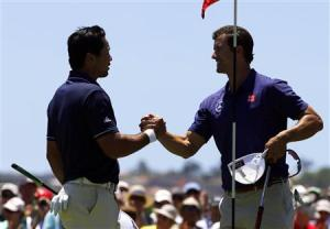 Australia's Scott shakes hands with playing partner and fellow countryman Day after they finished their first rounds of the Australian Open golf tournament at Royal Sydney Golf Club