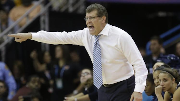 Connecticut head coach Geno Auriemma directs his team against Notre Dame in the first half of the women's NCAA Final Four college basketball tournament semifinal against Notre Dame, Sunday, April 7, 2013, in New Orleans. (AP Photo/Gerald Herbert)
