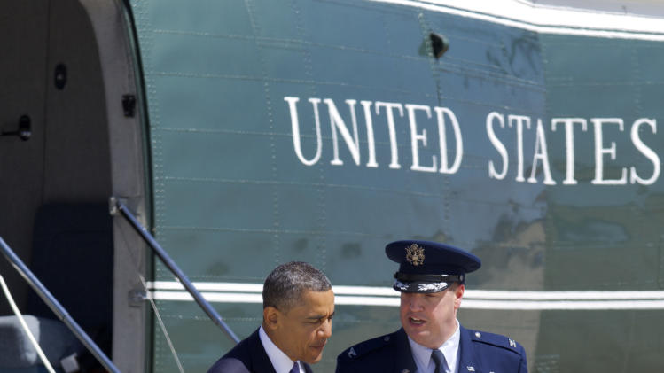 President Barack Obama walks with Col. Dale S. Holland, Vice Commander of the 89th Airlift Wing, before boarding Air Force One en route to Colorado, from Andrews Air Force Base, Md.,  Wednesday, April 3, 2013. (AP Photo/Jacquelyn Martin)