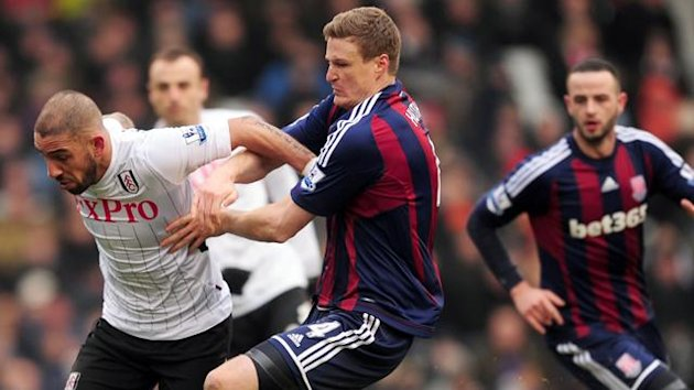 Fulham's Ashkan Dejagah (left) and Stoke City's Robert Huth battle for the ball (PA Photos)