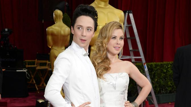 Johnny Weir and Tara Lipinski running to NBC's Kentucky Derby coverage