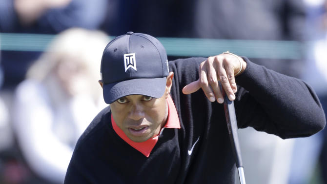 Tiger Woods lines up a putt on the second hole during the final round of the Honda Classic golf tournament on Sunday, March 3, 2013, in Palm Beach Gardens, Fla. (AP Photo/Wilfredo Lee)