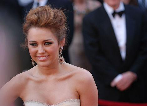 "Miley Cyrus and her ""Hunger Games"" boyfriend Liam Hemsworth are very supportive of each other."