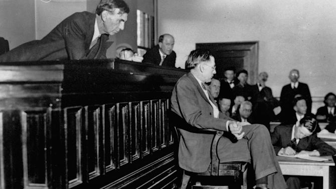 FILE - In this April 3, 1933 file photo, Judge James E. Horton leans over to listening to the testimony of Dr. R. R. Bridges, a Scottsboro, Ala. physician, in the Decatur, Ala. courtroom for the first of the retrials of eight of the nine Scottsboro black youths previously condemned to death for attacks on two white girls, Victoria Price and Ruby Bates. He said that he had found only superficial bruises and scratches when he examined Mrs. Price shortly after she was alleged to have been attacked aboard a train en route to Chattanooga. (AP Photo)