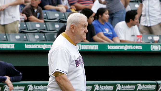 FILE - In this Aug. 16, 2008, file photo, former Texas Rangers clubhouse manager Joe Macko walks on the field before the Rangers' baseball game against the Tampa Bay Rays in Arlington, Texas. Macko, who hit 306 home runs in nearly 2,000 minor league games before a long career as a clubhouse manager with the Rangers, has died. He was 86. The Rangers said Macko died Friday, Dec. 26, 2014, at an assisted living center in Fort Worth, Texas. (AP Photo/Tony Gutierrez, File)