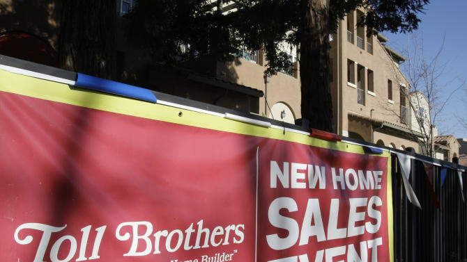 A sign advertises a sale event outside of a Toll Brothers housing project in San Jose, Calif., Tuesday, Feb. 22, 2011. Toll Brothers Inc. posted a surprise first-quarter profit, helped by a larger tax benefit, a higher average delivery price for its homes and more normalized cancellation rates.(AP Photo/Paul Sakuma)