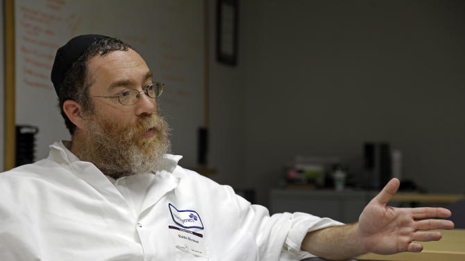 In this Friday, April 26, 2013 photo, Rabbi Pinchas Herman responds during an interview at Novozymes North America Inc. in Franklinton, N.C., where he routinely inspects machinery used for enzyme production for kosher products. The inspection is an example of how the centuries-old dietary code of observant Jews is adapting to its role as a mark of quality in the global food and drinks industry. (AP Photo/Gerry Broome)