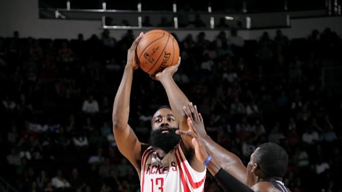 Motiejunas scores 23 to lead Rockets over Magic 107-94