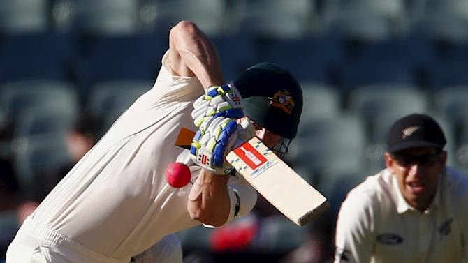 New Zealand's Ross Taylor watches as Australia's Shaun Marsh hits a boundary during the third day of the third cricket test match at the Adelaide Oval, in South Australia