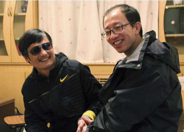 In this photo taken in late April, 2012, and provided by Hu Jia, blind Chinese legal activist Chen Guangcheng, left, meets with Hu at an undisclosed location. Chen, an inspirational figure in China's