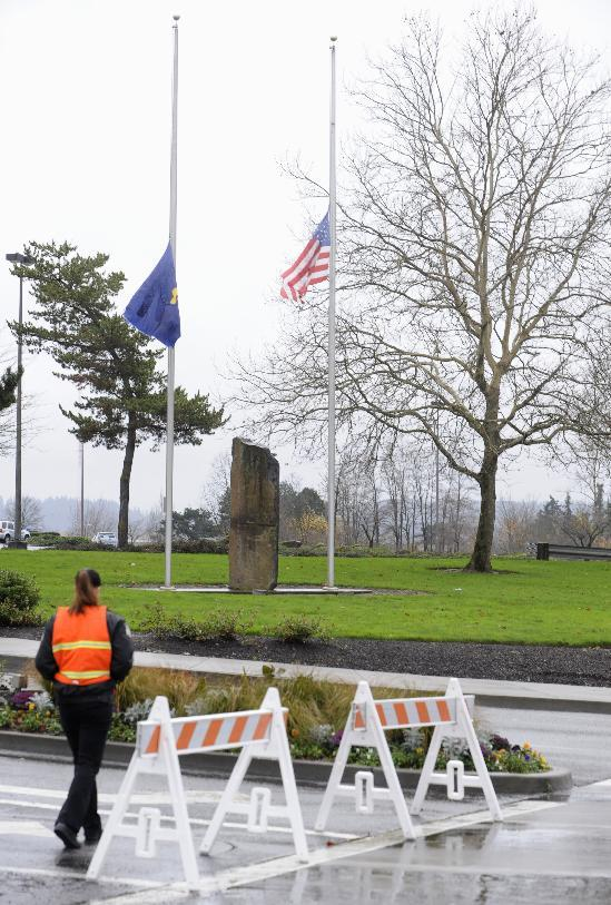 Flags fly at half staff Wednesday Dec. 12, 2012, at the entrance to the scene of a multiple shooting Tuesday at Clackamas Town Center Mall in Portland, Ore. Jacob Tyler Roberts  killed two people and himself in the shooting rampage. (AP Photo/Greg Wahl-Stephens)