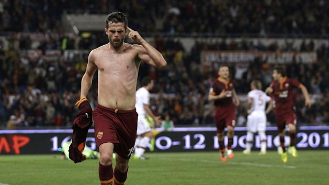AS Roma midfielder Miralem Pjanic of Bosnia-Erzegovina celebrates after scoring  during an Italian Serie A soccer match between Roma and AC Milan at Rome's Olympic stadium, Friday, April 25, 2014