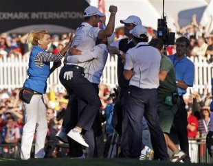 Germany&amp;#39;s Martin Kaymer celebrates winning his match against Stricker to retain the Ryder Cup. (Reuters)