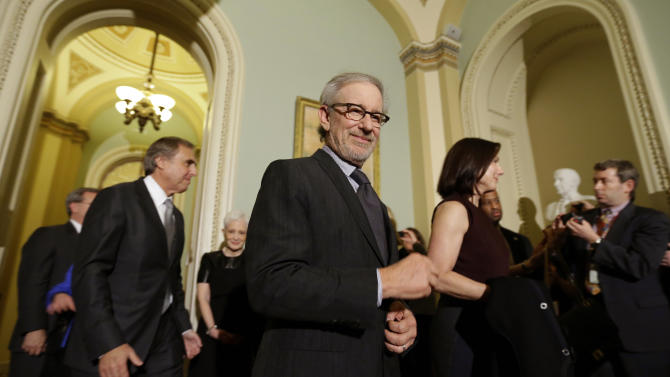"""Director Steven Spielberg, and others depart after a media availability, before a screening of the movie """"Lincoln,"""" for members of Congress, on Capitol Hill, Wednesday, Dec. 19, 2012 in Washington. (AP Photo/Alex Brandon)"""