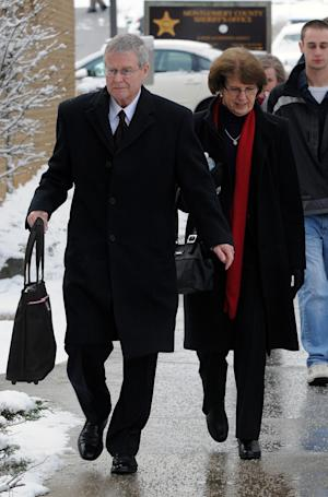 Harry Pryde, left, and his wife Karen, parents of the late Julia Pryde, walk into Montgomery County Circuit Court, on the first day of a scheduled week long civil trial in the wrongful death case brought against Virginia Tech and the Commonwealth of Virginia in Christiansburg, Va., Monday, March 5, 2012. (AP Photo/Don Petersen)