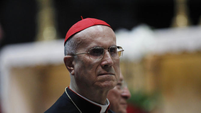 Vatican secretary of state cardinal Tarcisio Bertone attends a meeting with priests and religious at the Duomo gothic cathedral, in Milan, Italy, Saturday, June 2, 2012. Benedict's three-day trip to Milan for events focusing on the institution of the family is a welcome pastoral respite from an embarrassing and damaging leaks scandal at the Vatican that has engulfed the pontiff's personal butler. In contrast to the strains at home, the pontiff was welcomed by tens of thousands of cheering well-wishers in the square outside Milan's emblematic Cathedral earlier Friday. (AP Photo/Luca Bruno)