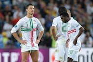 Portuguese forward Cristiano Ronaldo and Portuguese forward Silvestre Varela look dejected at the end of the Euro 2012 football championships semi-final match Portugal vs Spain at the Donbass Arena in Donetsk. Spain won 4-2 on penalties