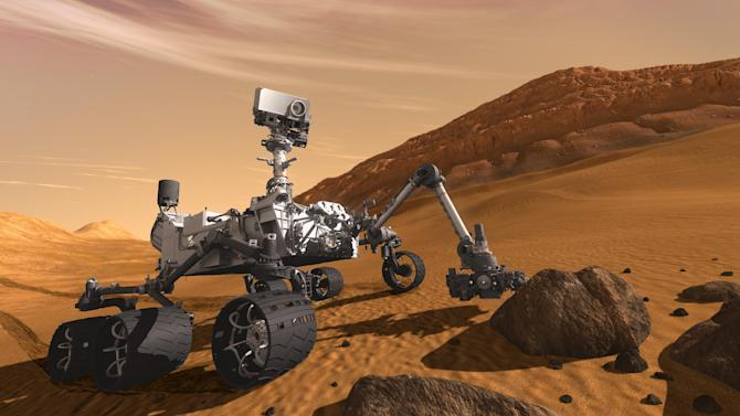 FILE - In this 2011 artist's rendering provided by NASA/JPL-Caltech, the Mars Science Laboratory Curiosity rover examines a rock on Mars. After traveling 8 1/2 months and 352 million miles, Curiosity will attempt a landing on Mars the night of Aug. 5, 2012.   (AP Photo/NASA/JPL-Caltech, file)