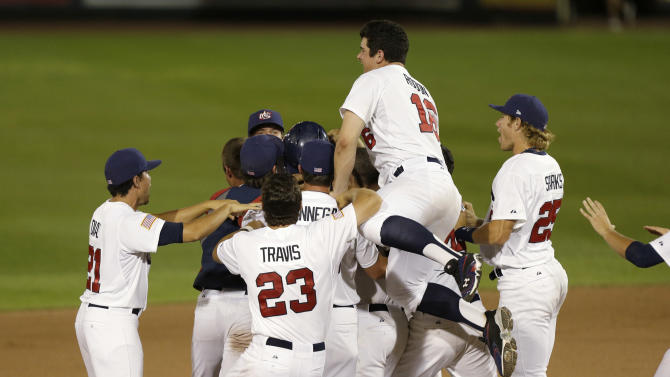 United States players celebrate after their 2-1 victory over Cuba an exhibition baseball game, Thursday, July 18, 2013, in Des Moines, Iowa. (AP Photo/Charlie Neibergall)