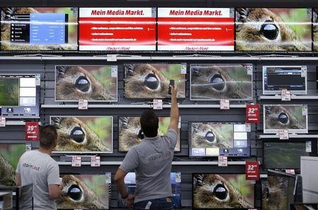 Employees of German electronics retailer Media-Saturn switch on television in their European state-of-the-art store in Ingolstadt