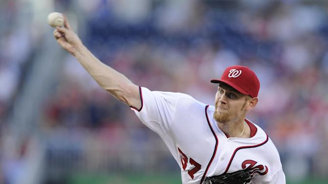 Washington Nationals starting pitcher Stephen Strasburg delivers during the third inning of a baseball game against the Colorado Rockies, Friday, June 21, 2013, in Washington. (AP Photo/Nick Wass)