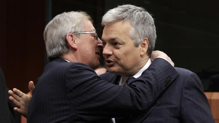Luxembourg's Prime Minister Jean-Claude Juncker, left, greets Belgium's Finance Minister Didier Reynders during a round table meeting of the eurogroup at the EU Council building in Brussels on Tuesday, Nov. 29, 2011. The 17 finance ministers of countries that use the euro converged on EU headquarters Tuesday in a desperate bid to save their currency and to protect Europe, the United States, Asia and the rest of the global economy from a debt-induced financial tsunami. (AP Photo/Virginia Mayo)