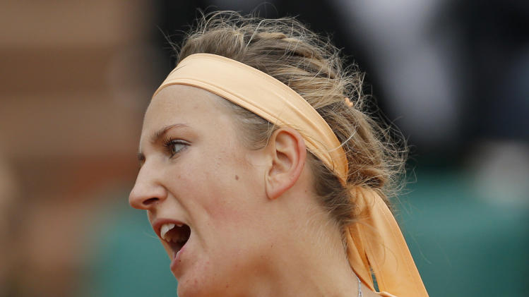 Victoria Azarenka of Belarus talks after missing a return in her fourth round match against Dominika Cibulkova of Slovakia at the French Open tennis tournament in Roland Garros stadium in Paris, Sunday June 3, 2012. Cibulkova won in two sets 6-2. 7-6. (AP Photo/Christophe Ena)