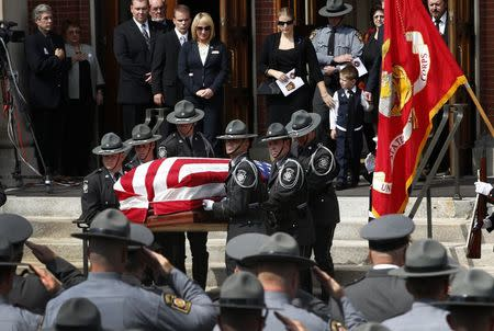 Pennsylvania State Police Troopers carry casket of slain Pennsylvania State Police Trooper Corporal Dickson from St. Peters' Cathedral in Scranton