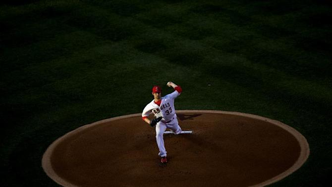 In this Monday, June 29, 2015, photo, Los Angles Angels' C.J. Wilson pitches against the New York Yankees during a baseball game in Anaheim, Calif. Anaheim won 4-1. (Matt Masin/The Orange County Register via AP)