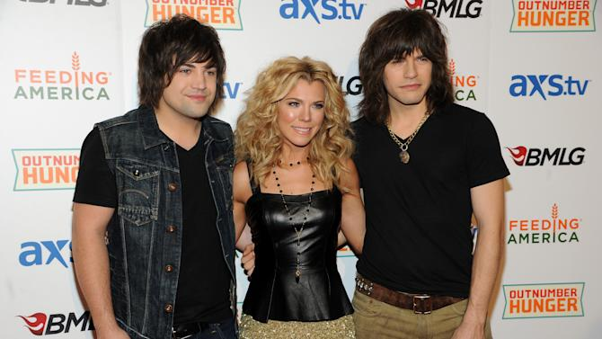 IMAGE DISTRIBUTED FOR OUTNUMBER HUNGER - From left, Neil Perry, Kimberly Perry and Reid Perry, of musical group The Band Perry, walk the red carpet at the Outnumber Hunger Live! concert at The Orleans Hotel & Casino in Las Vegas on Friday, April 5, 2013. The concert launched Outnumber Hunger, a collaboration between General Mills, Big Machine Label Group and Feeding America to help fight hunger in local communities. (Photo by Al Powers/Invision for Outnumber Hunger/AP Images)