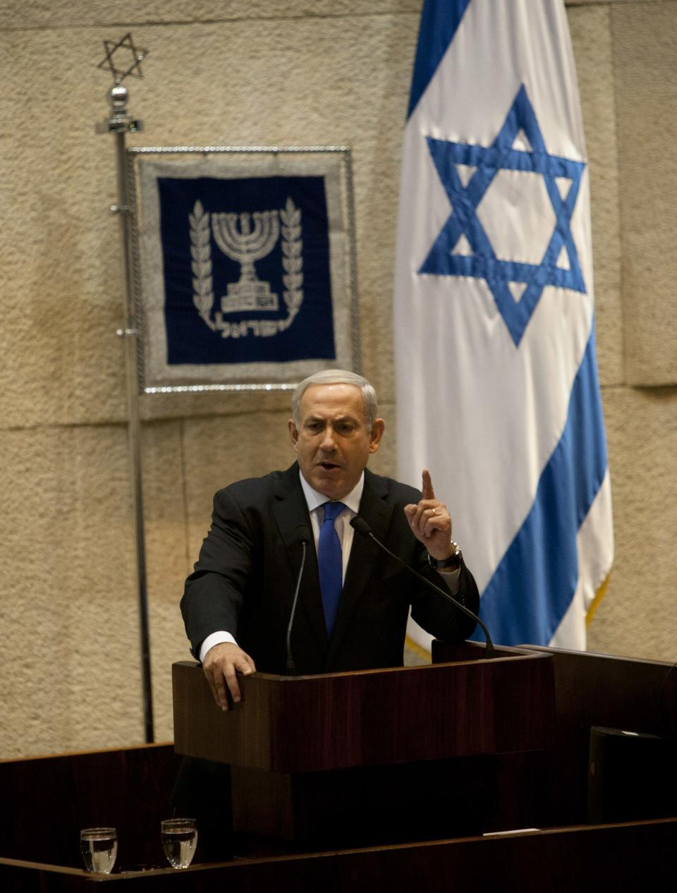 Israeli Prime Minister Benjamin Netanyahu gestures as he delivers a speech at the Knesset, Israel's parliament in Jerusalem, Monday, Oct. 15, 2012.  Israel's parliament has gathered for a vote to dissolve itself and hold early parliamentary elections. (AP Photo/Sebastian Scheiner)