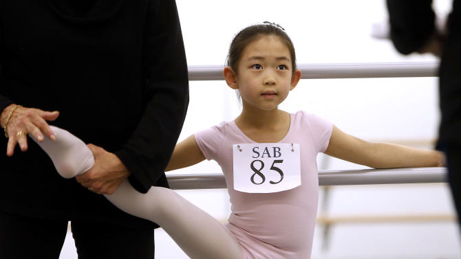 Yumi Park, 5, of Oakland Gardens, N.Y., is evaluated during an audition for six-year old ballet hopefuls at the School of American Ballet, Friday, April 5, 2013 in New York.  (AP Photo/Jason DeCrow)