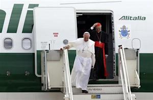 Pope Francis and Cardinal Bertone step off a plane after returning from their trip to Brazil at Ciampino airport, south of Rome