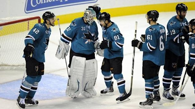 San Jose Sharks goalie Antti Niemi (31) is congratulated by team-mates (Reuters)