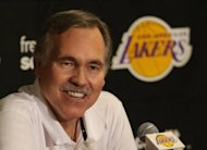 Los Angeles Lakers coach Mike D'Antoni speaks to the media ahead of their game against the Houston Rockets on November 18. He was hoping to make his Lakers head coaching debut Sunday night, but decided hours before the game that he was not quite ready to return