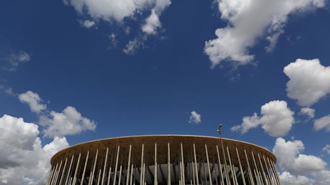 This April 7, 2014, photo, shows a view of the Mane Garrincha stadium, in Brasilia, Brazil. The cost of building Brasilia's World Cup stadium has nearly tripled, largely due to allegedly fraudulent billing, government auditors say. The spike in costs has made it the world's second-most expensive soccer arena, even though the city has no major professional team. (AP Photo/Eraldo Peres)