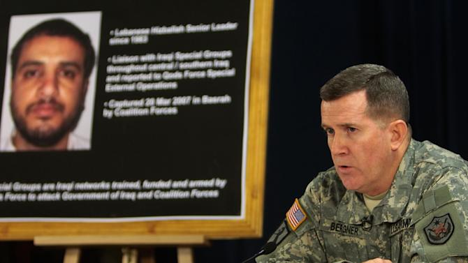 FILE - In this July 2, 2007 file photo, U.S. military spokesman Brig. Gen. Kevin J. Bergner speaks during a press conference in Baghdad, Iraq, near a poster of a senior Lebanese Hezbollah operative Ali Mussa Daqduq. The U.S. believes Daqduq is a top threat to Americans in the Mideast, and had asked to extradite him even before two Iraqi courts found him not guilty of masterminding the 2007 raid on a military base in the holy Shiite city of Karbala. (AP Photo/Wathiq Khuzaie, Pool, File)
