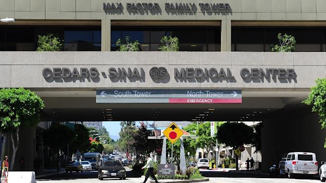 The Cedars-Sinai Medical Center, entrance seen here, may have unwittingly infected nearly 70 patients with a treatment-resistant superbug, it said Wednesday, becoming the second Los Angeles hospital to issue an alert