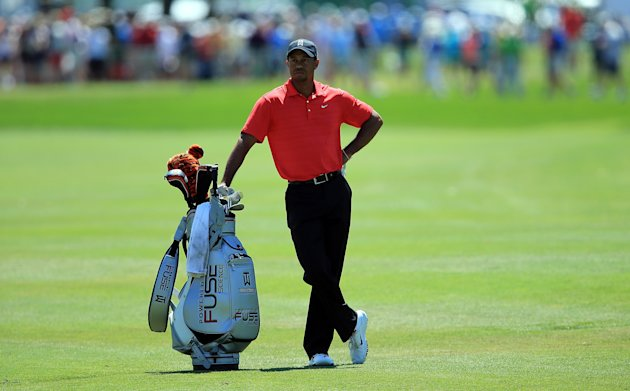 Tiger Woods of the USA waits to play his second shot at the par 4, first hole