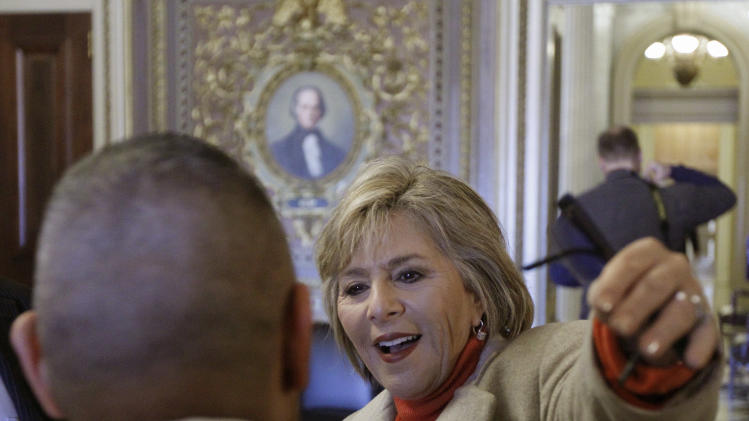 "Sen. Barbara Boxer, D-Calif., hugs ""Don't Ask Don't Tell"" supporter Eric Alva, a former Marine, near the floor of the Senate on an unusual Saturday session on Capitol Hill in Washington Saturday, Dec. 18, 2010.  (AP Photo/Alex Brandon)"