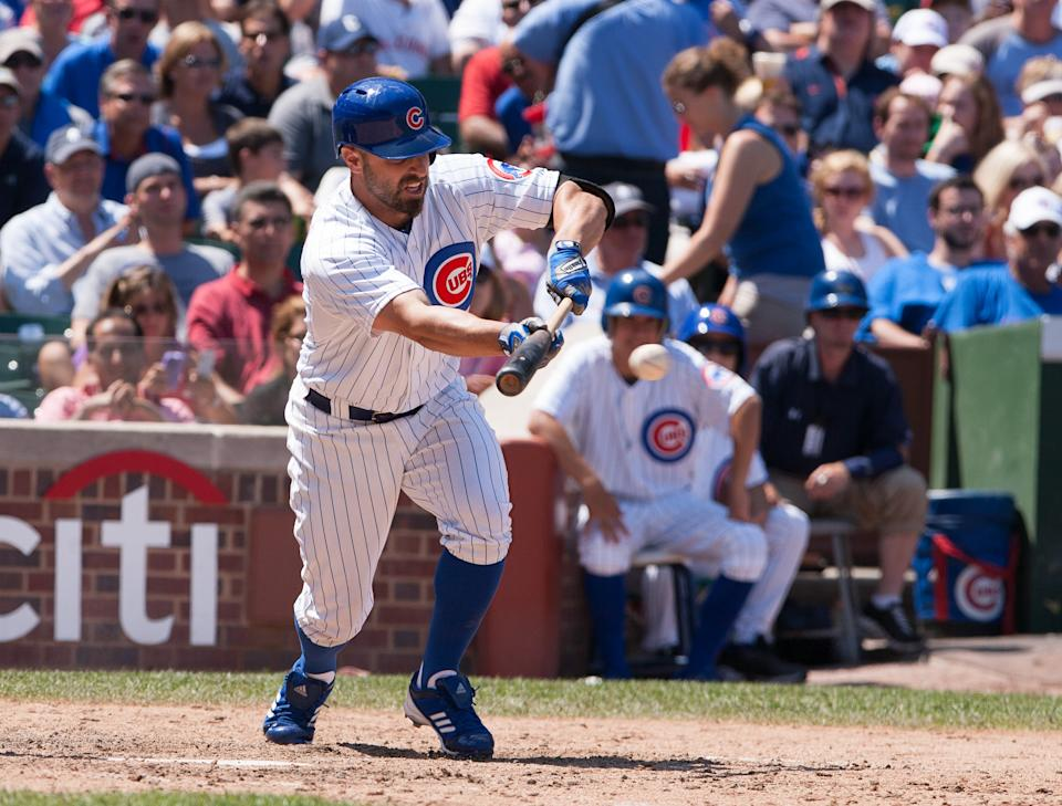 Chicago Cubs' Reed Johnson hits to score Tony Campana in the seventh inning against the St Louis Cardinals during a baseball game in Chicago, Saturday, July 28, 2012. The Cubs won 3-2. (AP Photo/Charles Cherney)