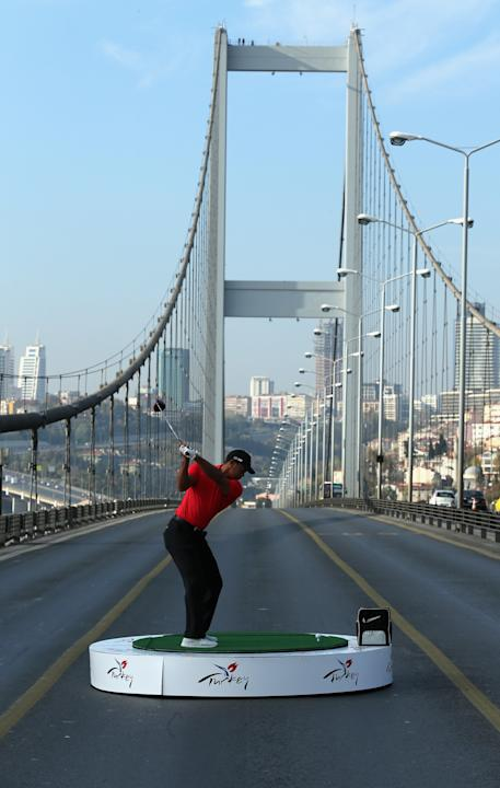 Tiger Woods drives from Asia to Europe