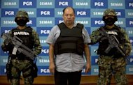Mexican Navy members escort Mario Cardenas Guillen (C), alleged leader of the Gulf drug cartel, during his presentation to the press in Mexico City. According to the Navy's spokesman, Cardenas was arrested during a military operation in Altamira, Tamaulipas on September 3