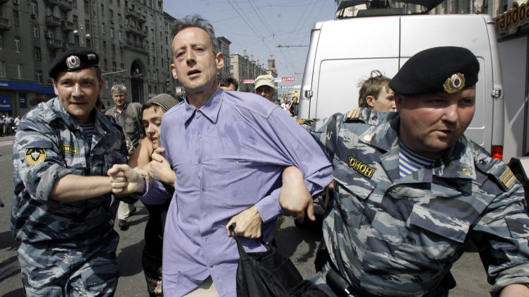 "FILE - In this Sunday, May 27, 2007 file photo, riot police officers detain British human rights activist Peter Tatchell as gay rights activists try to hold a demonstration in downtown Moscow. Tatchell says he has been meeting frequently with the London Olympic organizers to seek an extensive gay and transgender role in the games, and described the results thus far as ""a huge disappointment."" ""The only things that have happened have been the pin badges and the recruitment of LGBT volunteers,"" he said. (AP Photo/Sergey Ponomarev)"