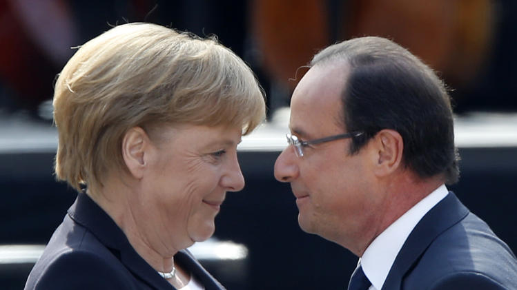 German Chancellor Angela Merkel, left, and French President Francois Hollande hug in the yard of the castle in Ludwigsburg, Germany, Saturday, Sept.22, 2012. Merkel and Hollande attend the celebration of the 50th anniversary of former French President Charles de Gaulle's speech to the youth of Germany. (AP Photo/Michael Probst)