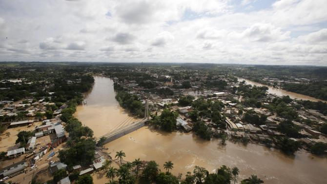 An aerial view of the flooded Acre river between Brasilia, Brazil (R) and Cobija, Bolivia
