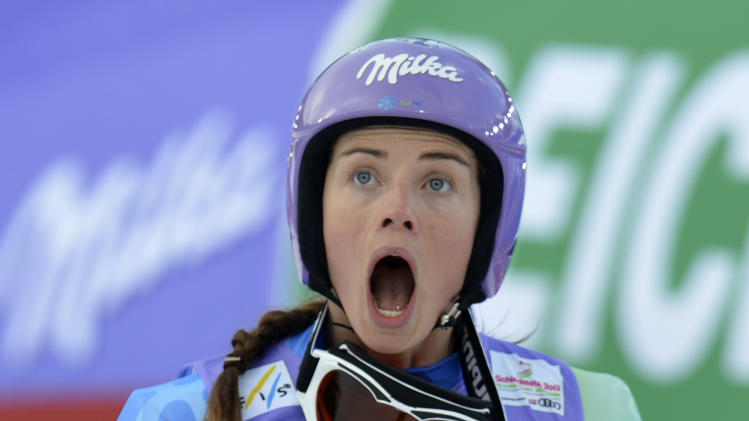 Slovenia's Tina Maze reacts as she see United States' Lindsey Vonn crashing during the women's super-G at the Alpine skiing world championships in Schladming, Austria, Tuesday, Feb.5,2013. (AP Photo/Kerstin Joensson)