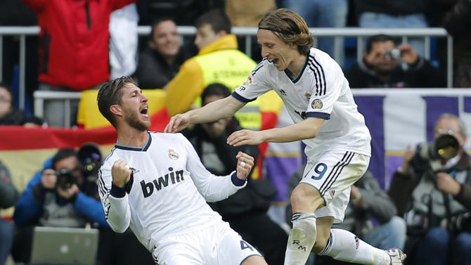 Real Madrid's Sergio Ramos, left celebrates with Luka Modric from Croatia after scoring Real Madrid's second goal against Barcelona during a Spanish La Liga soccer match at the Santiago Bernabeu stadium in Madrid, Saturday March 2, 2013. (AP Photo/Paul White)